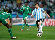 Argentina's forward Lionel Messi (R) controls the ball in front Nigeria's defender Chidi Odiah (L) during the World Cup South Africa 2010 soccer match, at Soccer City stadium, in Johannesburgo, South Africa, on June 12, 2010.  (Alejandro Pagni/PHOTOXPHOTO)