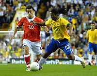 Photo: Ed Godden.<br /> Brazil v Wales. International Friendly. 05/09/2006.<br /> Simon Davies (L) challenges Brazil's Ronaldinho.