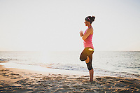 Jacki Arevalo practices yoga on a beach in Nassau, Bahamas during the sunset.