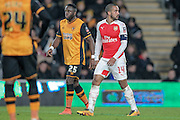 Theo Walcott (Arsenal) and Adama Diomandé (Hull City) during the The FA Cup fifth round match between Hull City and Arsenal at the KC Stadium, Kingston upon Hull, England on 8 March 2016. Photo by Mark P Doherty.