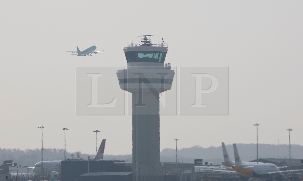 © licensed to London News Pictures. London, UK 23/03/2012. A plane takes off from Gatwick Airport. Photo credit: Tolga Akmen/LNP