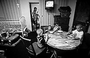 The two rooms at the Town and Country Motel are home for Cora McNeil, her boyfriend Mike and their six children. The kids eat their meals around a table while Cora and Mike eat at the coffee table in the other room. After dinner the table is moved to the side and the room becomes a bedroom for the children. (Mike Fender Photo) w/ story
