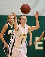 Kennedy's Olivia Meier (4) eyes a lose ball during their game at Kennedy High School, 4545 Wenig Rd NE in Cedar Rapids on Tuesday evening, February 8, 2011. Iowa City West defeated Cedar Rapids Kennedy 62-53. (Stephen Mally/Freelance)