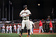 San Francisco Giants first baseman Brandon Belt (9) walks off the field after losing to the Cincinnati Reds at AT&T Park in San Francisco, California, on May 11, 2017. (Stan Olszewski/Special to S.F. Examiner)