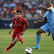 Fernando, (right), Manchester City, is challenged by Philippe Coutinho, Liverpool, during the Manchester City Vs Liverpool FC Guinness International Champions Cup match at Yankee Stadium, The Bronx, New York, USA. 30th July 2014. Photo Tim Clayton