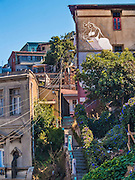 Valparaiso, February 2011. City view with graffiti of a couple on a wall. Valparaiso is known by and full of artistic graffitis.