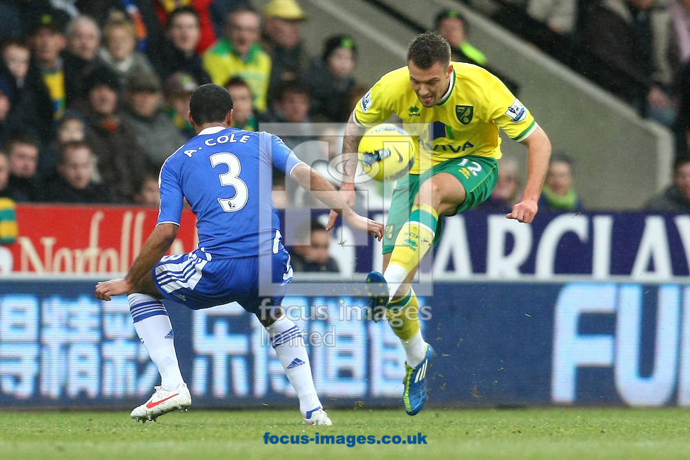 Picture by Paul Chesterton/Focus Images Ltd.  07904 640267.21/01/12.Ashley Cole of Chelsea and Anthony Pilkington of Norwich in action during the Barclays Premier League match at Carrow Road Stadium, Norwich.