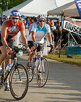 Martha Clement of Laconia begins the 55 mile bike portion of the Ironman 70.3 Timberman relay with her teammates Jane Clement(swim) and Gretchen Gandini (run) on Sunday.  (Karen Bobotas/for the Laconia Daily Sun)