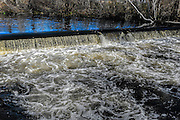 Water flowing over the dam at the Nemansket River at the Herring run in Middleborough, Massachusetts