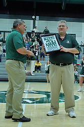 21 February 2017:  Mike Wagner presents Matt The Cat Adams with some tokens of appreciation during an College men's division 3 CCIW basketball game between the Augustana Vikings and the Illinois Wesleyan Titans in Shirk Center, Bloomington IL