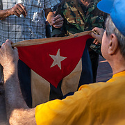 MIAMI, FLORIDA, APRIL 17, 2018<br /> Carlos Hernandez, 79, a member of the 5th Battalion  of the 2506 Brigade holds a Cuban flag as he commemorates  the 57th anniversary of the failed assault on Bay of Pigs  at their memorial in Little Havana by reading names of the ones who died in the operation.<br /> (Photo by Angel Valentin/Freelance)