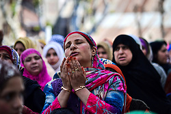 April 14, 2018 - Srinagar, J&K, India - A Kashmiri Muslim woman prays on the occasion of the Islamic festival Shab-e-Meraj  at Hazratbal Shrine in Srinagar, Indian administered Kashmir. Shab-e-Meraj, the night when the Holy Prophet Muhammad (PBUH) ascended to the highest levels of heavens, is being observed across the Kashmir valley with religious devotion and traditional fervor. The main gathering was held at the revered Hazratbal shrine where thousands of people from various parts of the Valley gathered for the nightlong prayers and for catching a glimpse of the holy relic of Prophet Muhammad  (Credit Image: © Saqib Majeed/SOPA Images via ZUMA Wire)
