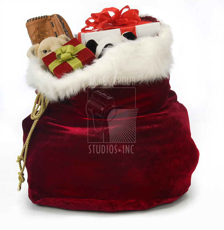 Santa's sack filled with toys on a white background