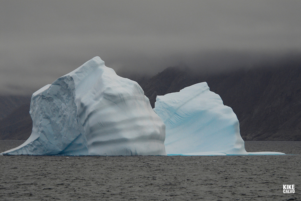 Icebergs from Greenland, drifting on Iceberg Alley. Davis Strait. Baffin Bay.  Baffin Island. High Arctic. Canada<br /> ( environment, global warming, ice, snow, white, blue, turquoise, inmense, mass, block, glacier, foggy, fog, ocean, arctic circle, winderness, view, trip, exploration, wild, scenic, scenics, seascape, tourist, cold