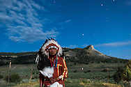 Reynard Faber, a Jicarilla Apache Chief stands in front of Dulce Rock, a prominent feature on the Dulce, NM reservation.