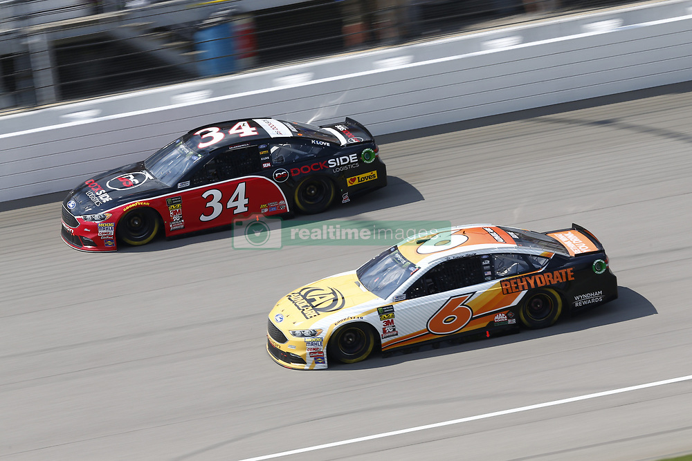 August 12, 2018 - Brooklyn, Michigan, United States of America - Trevor Bayne (6) and Michael McDowell (34) battle for position during the Consumers Energy 400 at Michigan International Speedway in Brooklyn, Michigan. (Credit Image: © Chris Owens Asp Inc/ASP via ZUMA Wire)