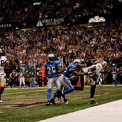 2009 September 13: New Orleans Saints wide receiver Marques Colston (12) catches a touchdown past the coverage of Detroit Lions defenders Eric King (29) and Louis Delmas (26) during a 45-27 win by the New Orleans Saints over the Detroit Lions at the Louisiana Superdome in New Orleans, Louisiana.