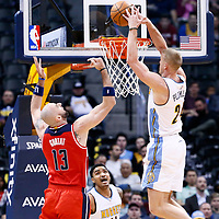 08 March 2017: Denver Nuggets center Mason Plumlee (24) goes for the dunk on Washington Wizards center Marcin Gortat (13) during the Washington Wizards 123-113 victory over the Denver Nuggets, at the Pepsi Center, Denver, Colorado, USA.