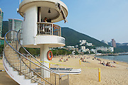 HONG KONG, CHINA - SEPTEMBER 16, 2012: Unidentified life guard on duty at Stanley town beach in Hong Kong, China. Stanley town is a tourist attraction in Hong Kong.