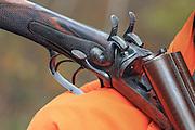 Close-up of a John Blanch side-lever shotgun.