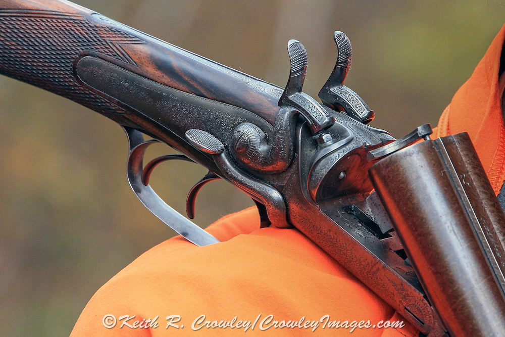 Close-up of a John Blanch side-lever shotgun.