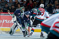 KELOWNA, CANADA - APRIL 26: Calvin Thurkauf #27 of the Kelowna Rockets checks Turner Ottenbreit #4 in front of the net of Carl Stankowski #1 of the Seattle Thunderbirds on April 26, 2017 at Prospera Place in Kelowna, British Columbia, Canada.  (Photo by Marissa Baecker/Shoot the Breeze)  *** Local Caption ***
