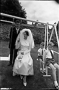 05/07/1967<br /> 07/05/1967<br /> 05 July 1967<br /> Wedding of George Walsh, eldest son of Mr and Ms Kevin G. Walsh, St. Rita's, Firhouse Road, Templeogue, Co. Dublin and Miss Arlene McMahon, elder daughter of Det. Chief Supt. Philip McMahon, Head of Special Branch, Dublin Castle and Mrs McMahon of Lisieux, Templeville Park, Templeogue, Co. Dublin who were married at the Carmelite Church, Terenure College, Dublin. An Taoiseach Mr Jack Lynch and Mrs Lynch; Mr Liam Cosgrave, leader Fine Gael and Mrs Cosgrave were among the 120 guests. Rev Fr H.E. Wright, O. Carm., Moate, officiated at the ceremony. The reception was held at Downshire Hotel, Blessington, Co. Wicklow. Bride and groom go for a swing with the page boys.