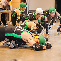 Buster Chops #321 and Bigg Rigg #815 stretching before the Columbus, OH - Ohio Roller Girls, Gang Green bout starts. ..Pittsburgh, PA, Steel Hurtin' VS. the Ohio Roller Girls All Stars..Pittsburg PA Steel Beamers VS. Ohio Roller Girls Gang Green ..6 April 2013: at Louche Building - Ohio Expo Center in Columbus, Ohio. Dorn Byg/Byg Day LLC