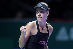 October 24, 2018 - Singapore - Angelique Kerber of Germany reacts to winning a point during the match between Angelique Kerber and Naomi Osaka on day 4 of the WTA Finals at the Singapore Indoor Stadium. (Credit Image: © Paul Miller/ZUMA Wire)