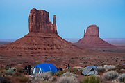 West & East Mittens at dusk seen from the tent campground Monument Valley Navajo Tribal Park, Arizona, USA.