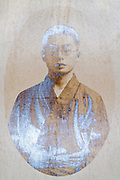 oval portrait of young adult person in kimono Japan early 1900s