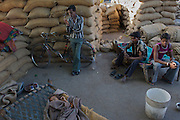 For a family working and living in a grain factory, the bicycle is an integral part of daily life.