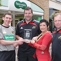 11/8/2008  IT'S a double win for Munster Rugby this year! Following the team?s Heineken Cup success, Munster Rugby has claimed the inaugural Specsavers' Fairplay League award for its exemplary disciplinary record within the Magners League. With indiscipline on the rugby pitch increasingly costing teams? vital points, the Specsavers Fairplay League celebrates good conduct on the field and Munster Rugby has topped the league for the club with the least disciplinary points for the 2007/08 season.  Presenting the award to Munsters  Anthony Foley in Specsavers, Limerick on Monday was Sinead Clohessy, Director, Specsavers, Cruise's street, Limerick under the watchful eye of international referee George Clancy (left) and Munsters' Tony McGahan (right).<br /> Photograph: Liam Burke/Press 22 (with compliments)<br /> <br /> As the club with the fewest red and yellow cards or citings during 2007/08, Munster Rugby has been awarded ?13,000 by Specsavers, the official optical partner and referee sponsor for the Magners League. The ?13,000 will be used to fund development in junior clubs within the Munster region. Munster player Anthony Foley and new coach Tony McGahan were in their local Specsavers store in Cruises Street, Limerick, today, Monday 11 August to collect the coveted award from store director Sinead Clohessy.<br /> <br /> Under the watchful eye of referee George Clancy, Munster Rugby star Anthony Foley comments: ?It's fundamental to the future of rugby that teams recognise the importance of every match's referee. At Munster Rugby we acknowledge how vital referees are to the game, insuring fair play, and we believe as one of the competition?s leading clubs that we must strive to set the standard. We are thrilled to win this award and would like to thank Specsavers for the donation which will be put to help to coach Munster players of the future.?  <br /> <br /> Specsavers chairperson in Ireland Hugh Morris says: ?Rugby is a game of passion and I am delighted to reward 