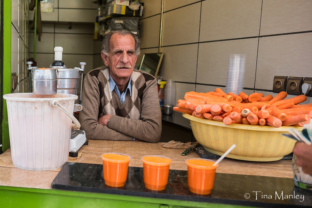 Small shop selling only carrot juice in Hamadan, Iran.