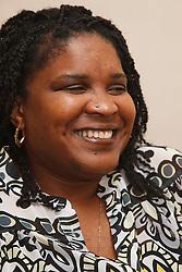 Portrait of black woman smiling.