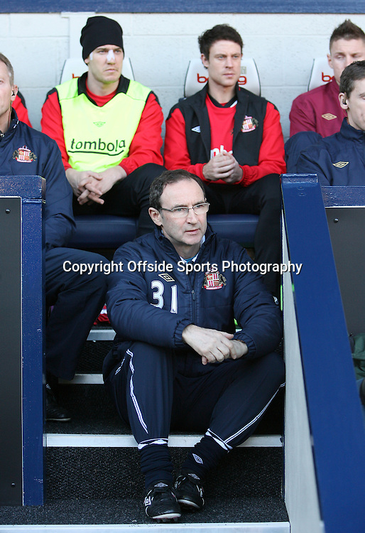 25/02/2012 - Barclays Premier League - West Bromwich Albion vs. Sunderland - Sunderland manager Martin O'Neill sits on the steps to the dugout in front of Nicklas Bendtner of Sunderland (L) and Wayne Bridge of Sunderland - Photo: Simon Stacpoole / Offside.