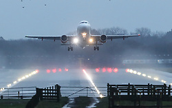 © Licensed to London News Pictures. 21/12/2018. Gatwick, UK. An aircraft takes off from Gatwick... Further delays are expected today after two days of disruption due to multiple sightings of drones over the airfield with thousands of passengers stranded. Photo credit: Peter Macdiarmid/LNP