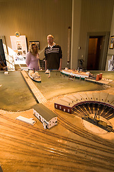 Railroad Museum in Donahue Depot, couple model released,  city of Tiburon on San Francisco Bay, CA, California.  Appealing community on Marin side with breakfast places, sailboats, outdoor dining, houses with scenic views, views of the Golden Gate, cormorant birdlife, public sculptures, a railroad museum, boutique art shops, and an historic China Cabin building from an ex-ship..Photo camari270-70599..Photo copyright Lee Foster, www.fostertravel.com, 510-549-2202, lee@fostertravel.com.
