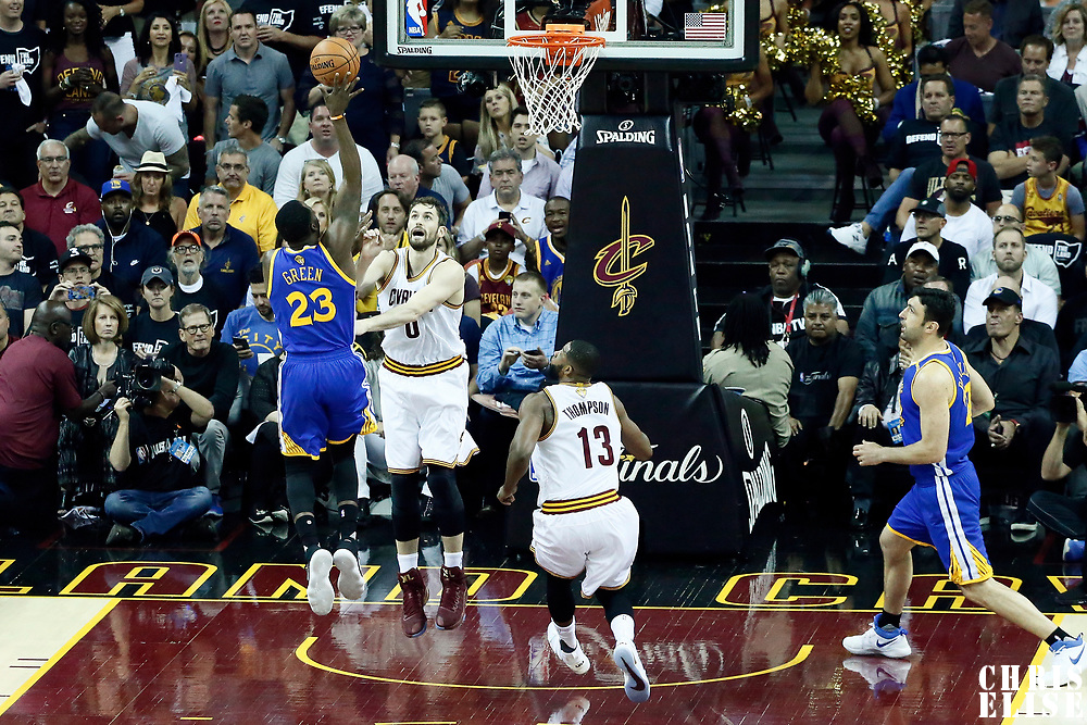 09 June 2017: Golden State Warriors forward Draymond Green (23) goes for the floater shot over Cleveland Cavaliers forward Kevin Love (0) during the Cleveland Cavaliers 137-11 victory over the Golden State Warriors, in game 4 of the 2017 NBA Finals, at  the Quicken Loans Arena, Cleveland, Ohio, USA.