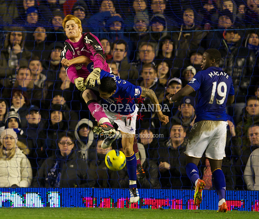 LIVERPOOL, ENGLAND - Wednesday, January 4, 2012: Everton's Tim Cahill in action against Bolton Wanderers' goalkeeper Adam Bogdan during the Premiership match at Goodison Park. (Pic by David Rawcliffe/Propaganda)