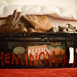 A trunk owned by Hemingway's wife Mary in the master bedroom is decorated with Hemingway's footwear from various outdoor activities.