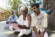 Villagers are reading the children's journal, compiled by Pooja, 14, a student from the village of Pathpuri, Hoshangabad, Madhya Pradesh, India, and other child reporters. The project was launched by Dalit Sangh, an NGO which has been working for the uplift of scheduled castes for the past 22 years. Dalit Sangh is working in collaboration with Unicef India to promote education and awareness within backward communities.