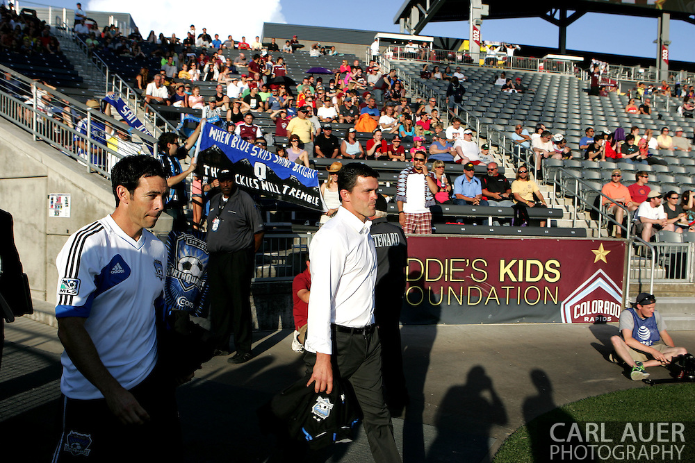 June 15th, 2013 - San Jose Earthquake interim head coach Mark Watson walks past a small small group of San Jose fans prior to the start of action in the MLS match between San Jose Earthquake and the Colorado Rapids at Dick's Sporting Goods Park in Commerce City, CO