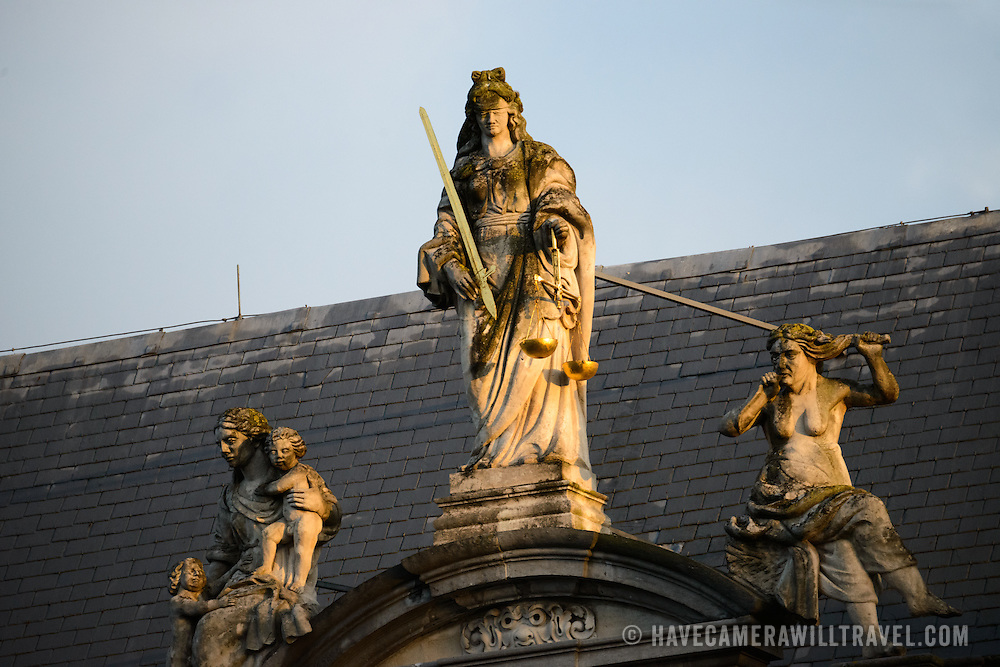 A statue of Justice on top of the Provost's House (Proosdij), a historic baroque building dating to 1666 on Burg Square and standing opposite the gothic City Hall (Stadhuis) building. The Provost's House was used as the residence of the bishop of Bruges and now houses the government offices of West Flanders province.
