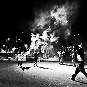 BALTIMORE, MD Monday, April 26, 2015: Protesters standoff with police after the 10pm curfew during the second day of riots that started after the funeral of Freddie Gray on West North Street in Baltimore, MD.  Credit: Byron Smith