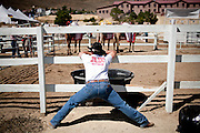 Ryan Gillaspie, of Pioneer, Calif. stretches before the 51st annual International Camel Races in Virginia City, Nevada  September 12, 2010. .CREDIT: Max Whittaker for The Wall Street Journal.CAMEL