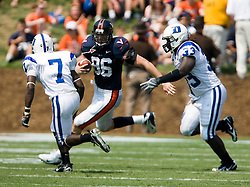 Virginia tight end Tom Santi (86) takes a Peter Lalich (7) pass up field for a 7 yard gain.  The Virginia Cavaliers defeated the Duke Blue Devils 23-14 at Scott Stadium in Charlottesville, VA on September 8, 2007  With the loss, Duke extended their longest-in-the-nation losing streak to 22 games.