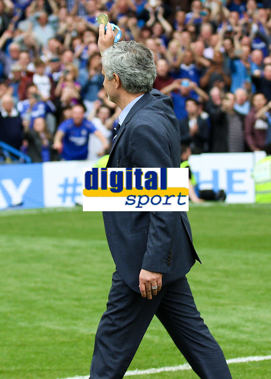 Football - 2014 / 2015 Premier League - Chelsea vs. Sunderland.   <br /> <br /> José Mourinho, Manager, of Chelsea FC shows his winners medal to the Chelsea fans at Stamford Bridge. <br /> <br /> COLORSPORT/DANIEL BEARHAM