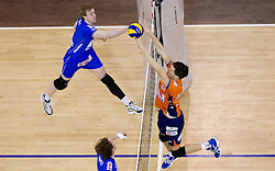 Sam Deroo of Knack Roeselare and Alen Sket of ACH during volleyball match between ACH Volley (SLO) and Knack Roeselare (BEL) at Quarterfinals of CEV Challenge Cup 2011/2012, on February 8, 2012 in Arena Tivoli, Ljubljana, Slovenia. ACH Volley defeated Knack Roeselare  3-0. (Photo By Vid Ponikvar / Sportida.com)
