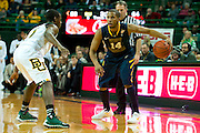 WACO, TX - JANUARY 28: Gary Browne #14 of the West Virginia Mountaineers brings the ball up court against the Baylor Bears on January 28, 2014 at the Ferrell Center in Waco, Texas.  (Photo by Cooper Neill/Getty Images) *** Local Caption *** Gary Browne